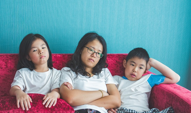 bored family fell a sitting on sofa at home